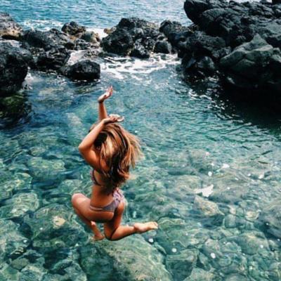 Bikini.com girl jumping into ocean